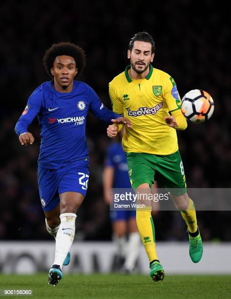 Willian of Chelsea and Mario Vrancic of Norwich City in action during The Emirates FA Cup Third Round Replay between Chelsea and Norwich City at...