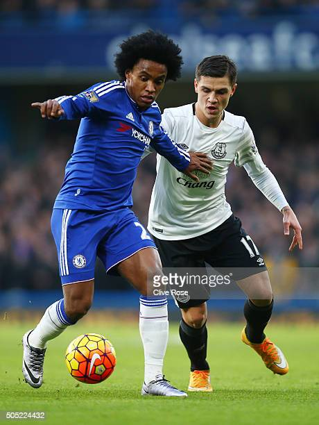 Willian of Chelsea and Muhamed Besic of Everton compete for the ball during the Barclays Premier League match between Chelsea and Everton at Stamford...