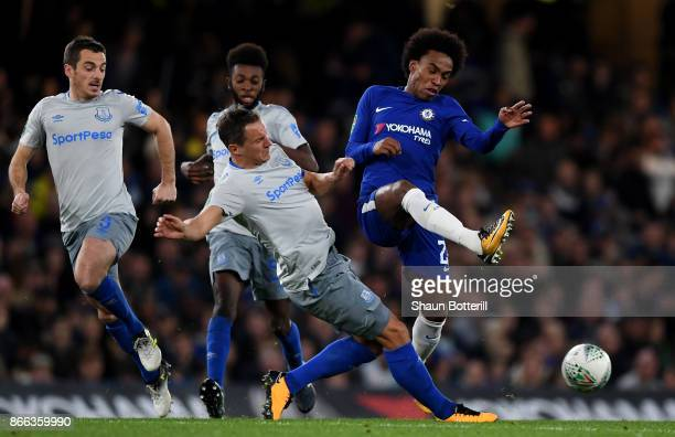 Willian of Chelsea and Phil Jagielka of Everton battle for possession during the Carabao Cup Fourth Round match between Chelsea and Everton at...