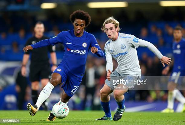 Willian of Chelsea and Tom Davies of Everton in action during the Carabao Cup Fourth Round match between Chelsea and Everton at Stamford Bridge on...