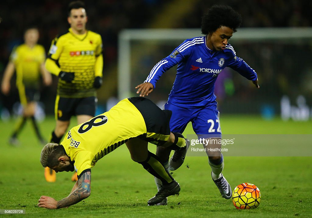 Willian of Chelsea and Valon Behrami of Watford battle for the ball during the Barclays Premier League match between Watford and Chelsea at Vicarage Road on February 3, 2016 in Watford, England.