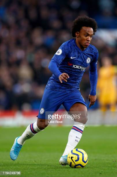 Willian of Chelsea battles for possession with Dan Gosling of Bournemouth during the Premier League match between Chelsea and Bournemouth at Stamford...