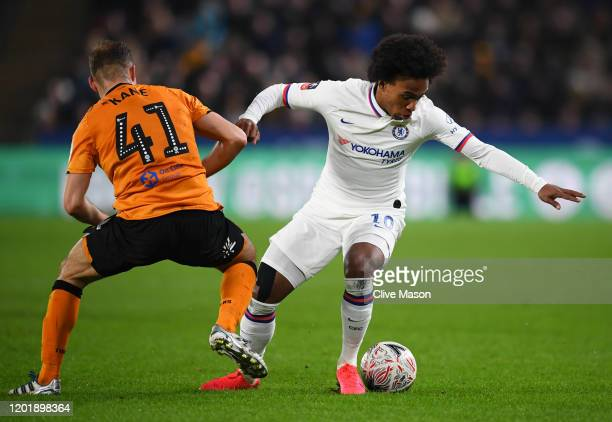 Willian of Chelsea battles for possession with Herbie Kane of Hull City during the FA Cup Fourth Round match between Hull City FC and Chelsea FC at...