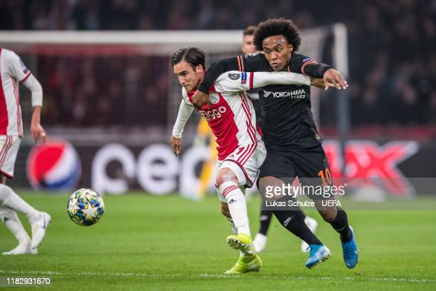 Willian of Chelsea battles for possession with Nico Tagliafico of Amsterdam during the UEFA Champions League group H match between AFC Ajax and...