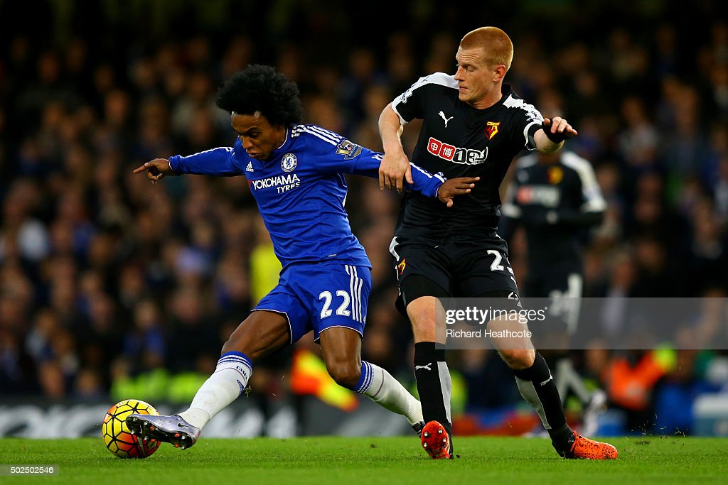 Willian of Chelsea battles for the ball with Ben Watson of Watford during the Barclays Premier League match between Chelsea and Watford at Stamford Bridge on December 26, 2015 in London, England.