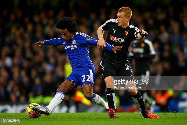 Willian of Chelsea battles for the ball with Ben Watson of Watford during the Barclays Premier League match between Chelsea and Watford at Stamford...