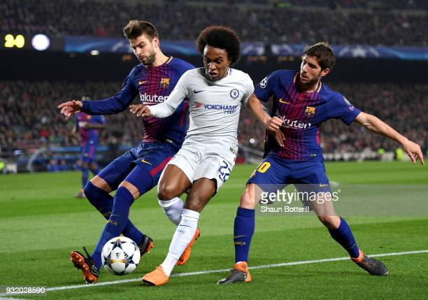 Willian of Chelsea battles with Gerard Pique and Sergi Roberto of Barcelona during the UEFA Champions League Round of 16 Second Leg match FC...