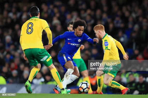 Willian of Chelsea battles with Harrison Reed of Norwich during The Emirates FA Cup Third Round Replay match between Chelsea and Norwich City at...