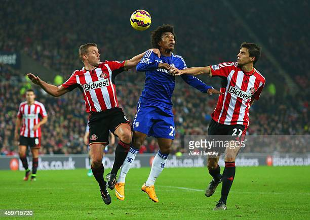 Willian of Chelsea battles with Lee Cattermole and Santiago Vergini of Sunderland during the Barclays Premier League match between Sunderland and...