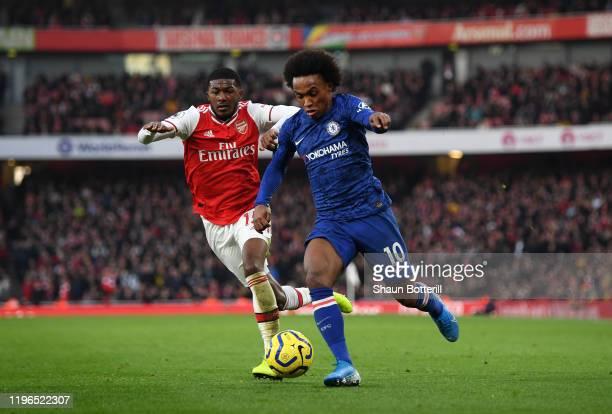 Willian of Chelsea breaks away from Ainsley MaitlandNiles of Arsenal during the Premier League match between Arsenal FC and Chelsea FC at Emirates...
