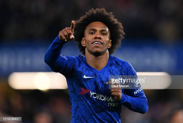 Willian of Chelsea celebrates after scoring his sides first goal during the FA Cup Fifth Round match between Chelsea FC and Liverpool FC at Stamford...