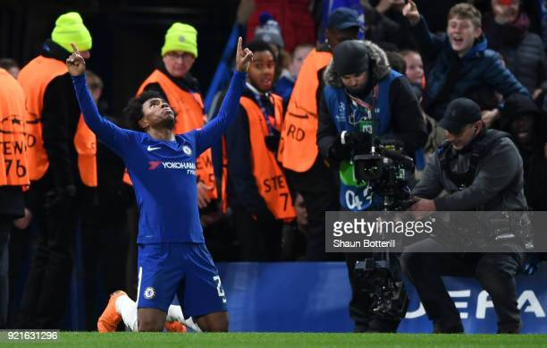 Willian of Chelsea celebrates after scoring his sides first goal during the UEFA Champions League Round of 16 First Leg match between Chelsea FC and...