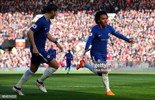Willian of Chelsea celebrates after scoring his sides first goal during the Premier League match between Manchester United and Chelsea at Old...