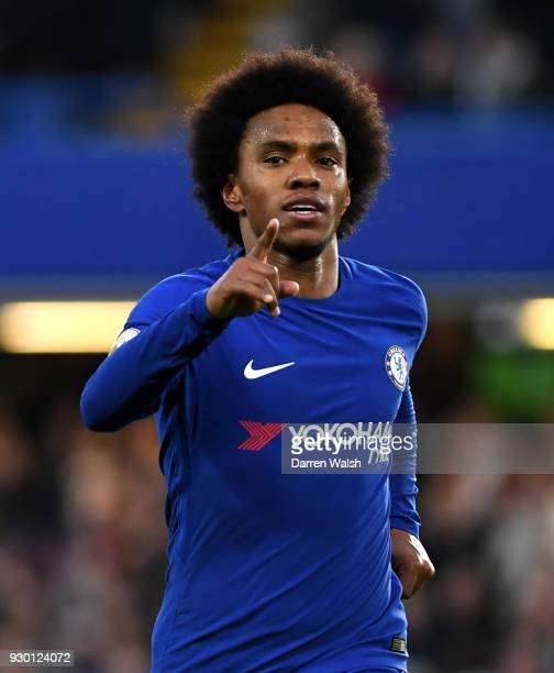 Willian of Chelsea celebrates after scoring his sides first goal during the Premier League match between Chelsea and Crystal Palace at Stamford...