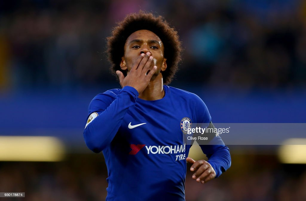 Willian of Chelsea celebrates after scoring his sides first goal during the Premier League match between Chelsea and Crystal Palace at Stamford Bridge on March 10, 2018 in London, England.