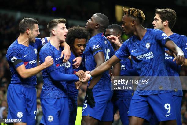 Willian of Chelsea celebrates after scoring his sides first goal with team mates during the Premier League match between Tottenham Hotspur and...