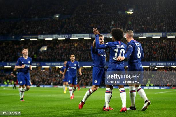 Willian of Chelsea celebrates after scoring his sides first goal with Cesar Azpilicueta of Chelsea during the FA Cup Fifth Round match between...