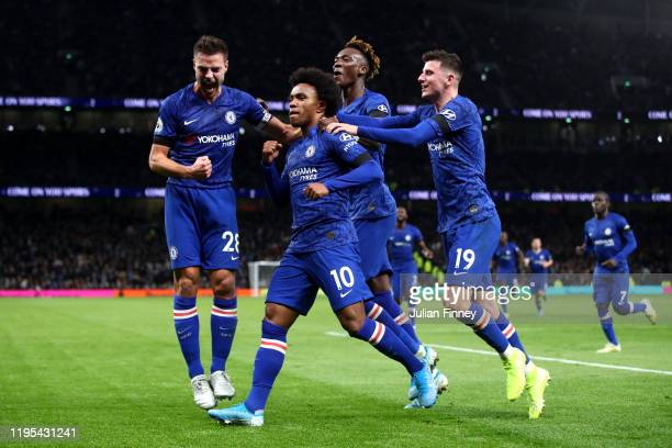 Willian of Chelsea celebrates after scoring his sides second goal during the Premier League match between Tottenham Hotspur and Chelsea FC at...