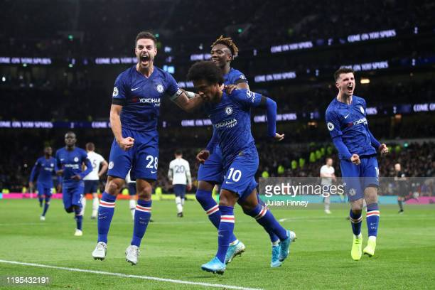 Willian of Chelsea celebrates after scoring his sides second goal with Cesar Azpilicueta and team mates during the Premier League match between...