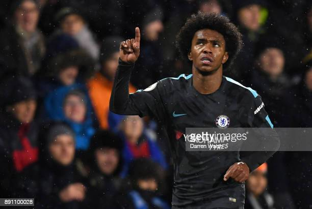 Willian of Chelsea celebrates after scoring his sides second goal during the Premier League match between Huddersfield Town and Chelsea at John...