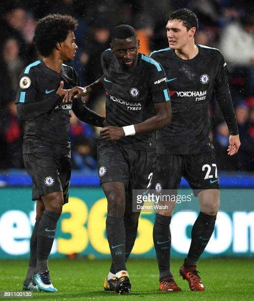 Willian of Chelsea celebrates after scoring his sides second goal with teammates Antonio Rudiger of Chelsea and Andreas Christensen of Chelsea during...