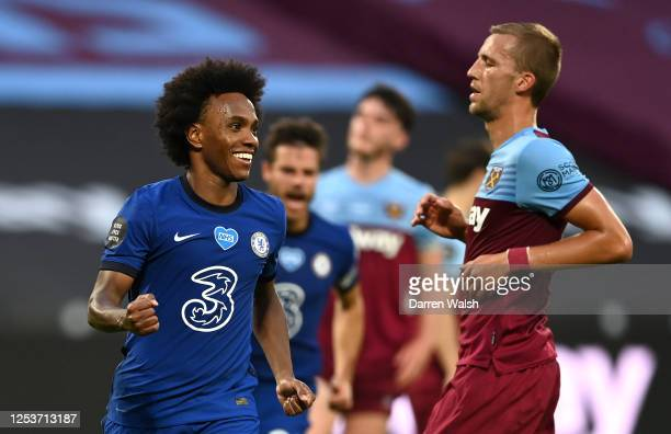 Willian of Chelsea celebrates after scoring his team's first goal from a penalty during the Premier League match between West Ham United and Chelsea...