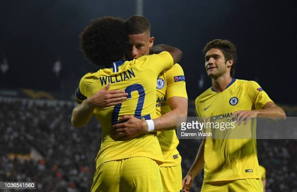 Willian of Chelsea celebrates after scoring his team's first goal with Ross Barkley of Chelsea during the UEFA Europa League Group L match between...