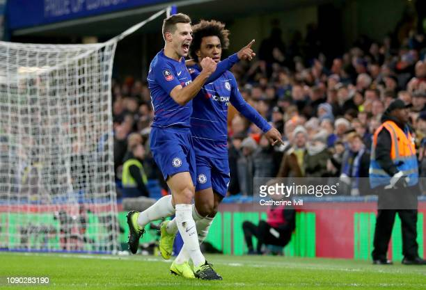 Willian of Chelsea celebrates after scoring his team's first goal with Cesar Azpilicueta of Chelsea during the FA Cup Fourth Round match between...