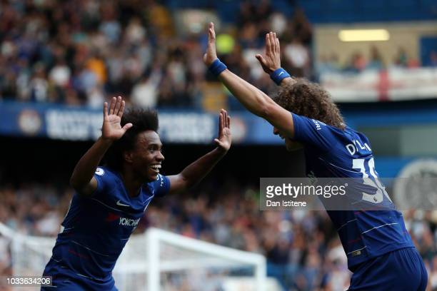 Willian of Chelsea celebrates after scoring his team's fourth goal with David Luiz during the Premier League match between Chelsea FC and Cardiff...