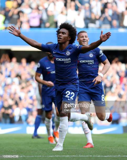Willian of Chelsea celebrates after scoring his team's fourth goal with team mates during the Premier League match between Chelsea FC and Cardiff...