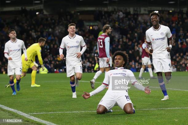 Willian of Chelsea celebrates after scoring his team's fourth goal during the Premier League match between Burnley FC and Chelsea FC at Turf Moor on...