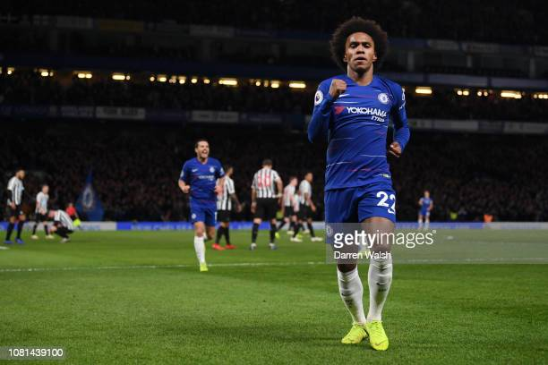 Willian of Chelsea celebrates after scoring his team's second goal during the Premier League match between Chelsea FC and Newcastle United at...