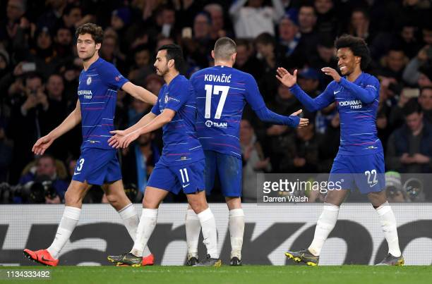 Willian of Chelsea celebrates after scoring his team's second goal with Mateo Kovacic of Chelsea during the UEFA Europa League Round of 16 First Leg...