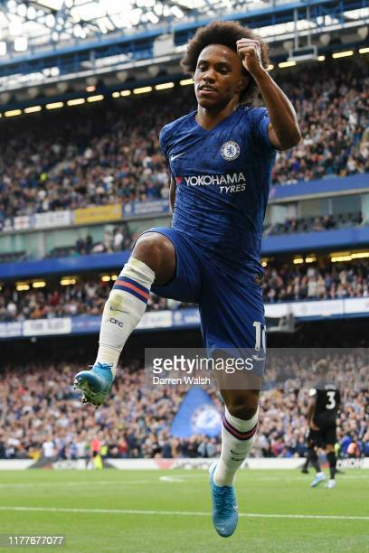 Willian of Chelsea celebrates after scoring his team's second goal during the Premier League match between Chelsea FC and Brighton & Hove Albion at...