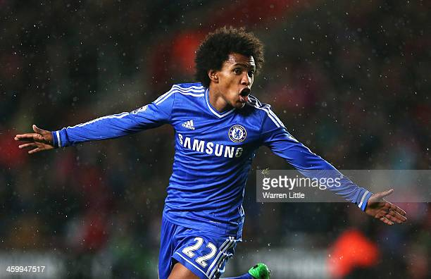 Willian of Chelsea celebrates after scoring his team's second goal during the Barclays Premier League match between Southampton and Chelsea at St...