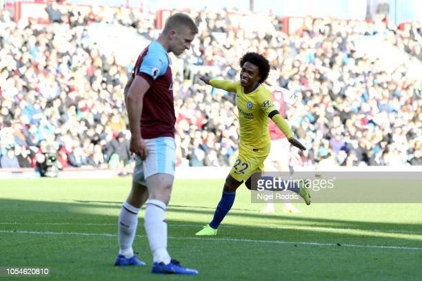 Willian of Chelsea celebrates after scoring his team's third goal during the Premier League match between Burnley FC and Chelsea FC at Turf Moor on...