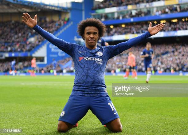 Willian of Chelsea celebrates after scoring his team's third goal during the Premier League match between Chelsea FC and Everton FC at Stamford...