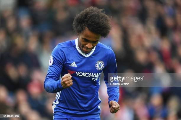 Willian of Chelsea celebrates as he scores their first goal during the Premier League match between Stoke City and Chelsea at Bet365 Stadium on March...