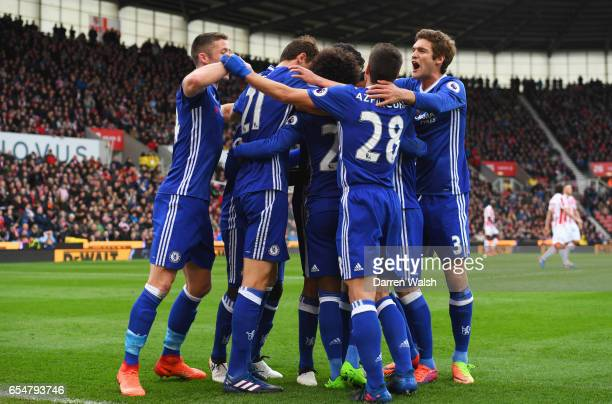 Willian of Chelsea celebrates as he scores their first goal with team mates during the Premier League match between Stoke City and Chelsea at Bet365...