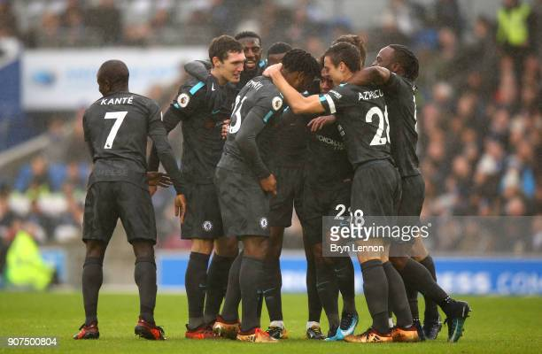 Willian of Chelsea celebrates as he scores their second goal with team mates during the Premier League match between Brighton and Hove Albion and...