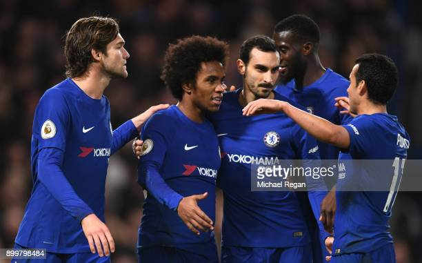 Willian of Chelsea celebrates scoring from the penalty spot for his team's fourth goal with Marcos Alonso and Davide Zappacosta during the Premier...