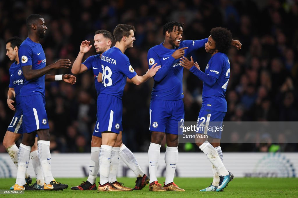 Willian (R) of Chelsea celebrates scoring from the penalty spot for his team's fourth goal during the Premier League match between Chelsea and Stoke City at Stamford Bridge on December 30, 2017 in London, England.