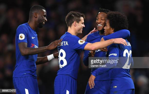 Willian of Chelsea celebrates scoring from the penalty spot for his team's fourth goal during the Premier League match between Chelsea and Stoke City...