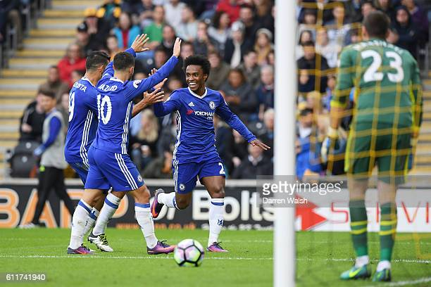Willian of Chelsea celebrates scoring his sides first goal during the Premier League match between Hull City and Chelsea at KCOM Stadium on October...