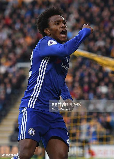 Willian of Chelsea celebrates scoring his sides first goal during the Premier League match between Hull City and Chelsea at KC Stadium on October 1...