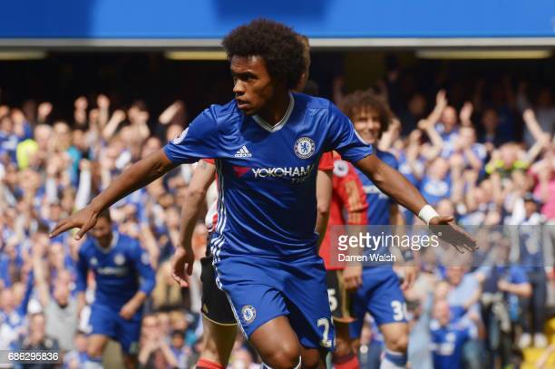 Willian of Chelsea celebrates scoring his sides first goal during the Premier League match between Chelsea and Sunderland at Stamford Bridge on May...