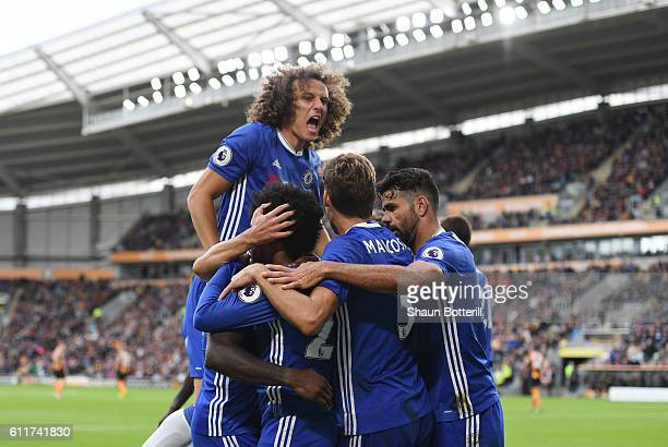 Willian of Chelsea celebrates scoring his sides first goal with his team mates during the Premier League match between Hull City and Chelsea at KCOM...