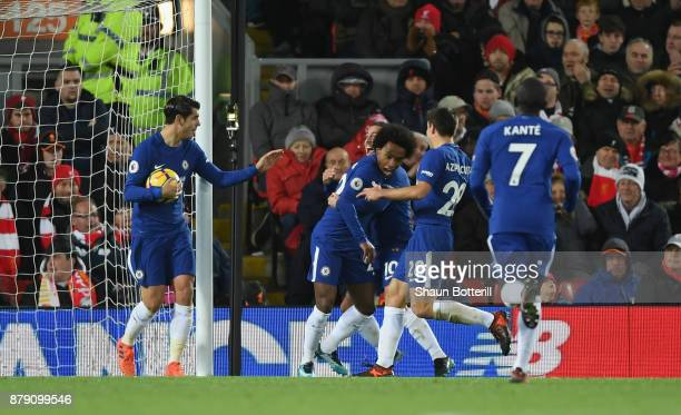 Willian of Chelsea celebrates scoring his sides first goal with his Chelsea team mates during the Premier League match between Liverpool and Chelsea...
