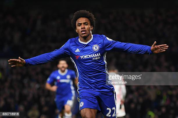 Willian of Chelsea celebrates scoring his side's second goal during the Premier League match between Chelsea and Stoke City at Stamford Bridge on...