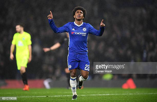 Willian of Chelsea celebrates scoring his sides third goal during The Emirates FA Cup Third Round match between Chelsea and Peterborough United at...